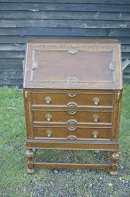 Fine carved oak bureau writing desk with telescopic interior