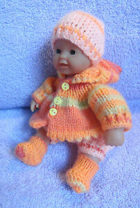 Hand knitted clothes for 8