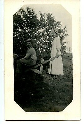 Farm Couple-Home Made Wheelbarrow or Wood Chair-RPPC-Vintage Real Photo Postcard