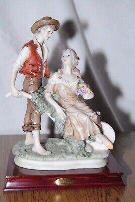 La Anina Collection Man Pushing Woman In Wheelbarrow Figurine
