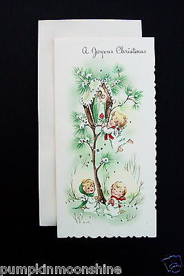 Unused Xmas Greeting Card Precious Angels Giving Baby Jesus a Red Rose at Shrine