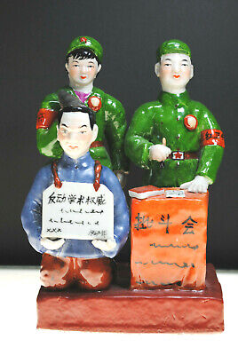 ANTIQUE PORECLAIN STATUE OF TWO KOREAN SOLDIERS WITH A PRISIONER SIGNED