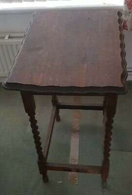 Solid top dark wood table, oak. Warped top, barley twist legs.