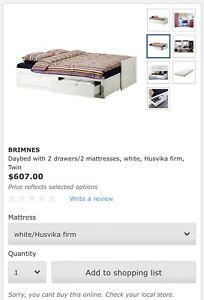 IKEA bed with drawers, and 3 mattresses in brown color