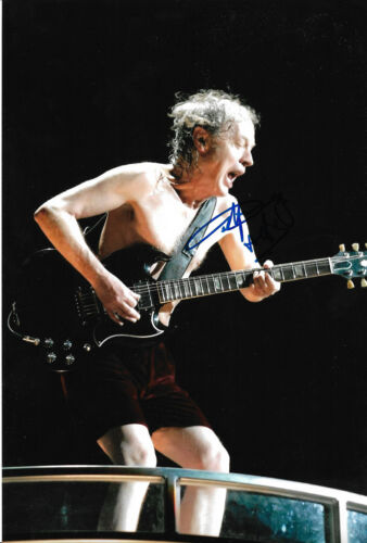 """Angus Young """"AC/DC"""" signed 8x12 inch photo autograph"""