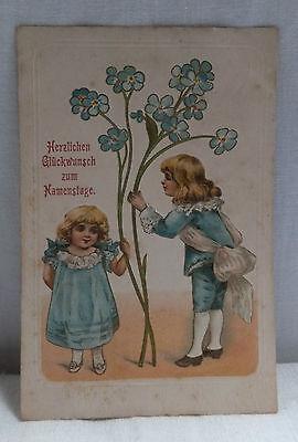 AK Prägekarte zum Namenstag zwei Kinder mit Blumengruss gel. 1908