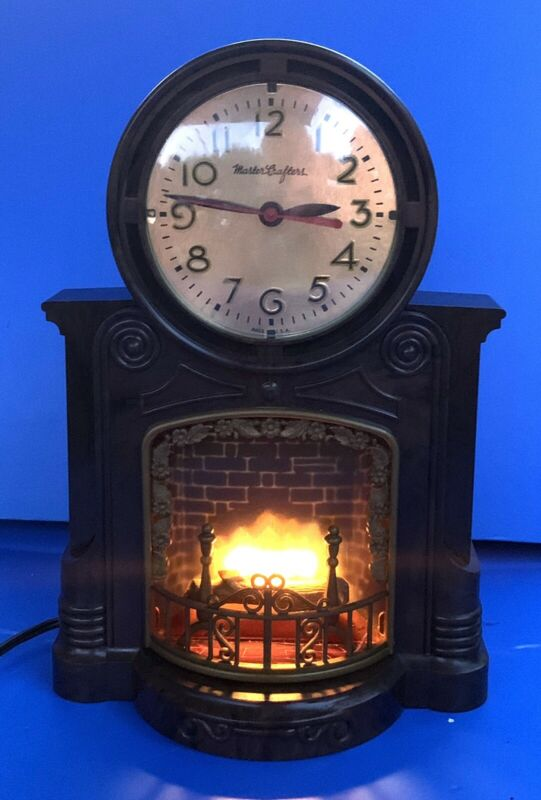 VINTAGE MASTERCRAFTERS FIREPLACE MOTION CLOCK-CLOCK RUNS & WORKS GREAT!!