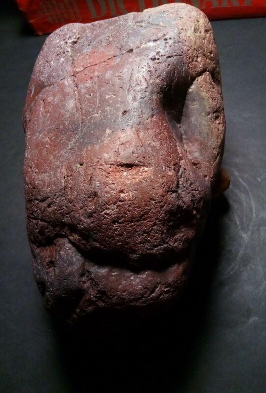 9.5 lb. red granite prehistoric rock art sculpture.