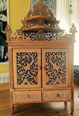 Antique Chinese Carved and fretwork camphor cabinet. Delicately carved