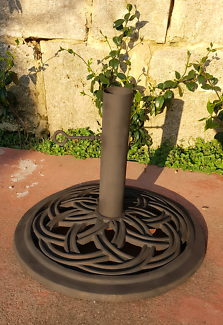 Wrought iron umbrella stand.