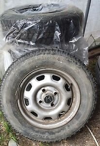 5 studded winter tires on rims 175/70/R13
