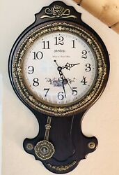 Elegant Hanging wall Clock. Framed In Splendid And Magnificent Wood And Brass.