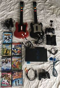 Ps2 with lots of accessories and 7 games