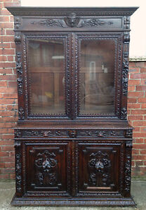 A 19th century flemish carved oak bookcase cabinet.