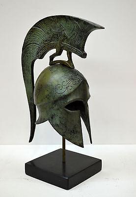 Bronze Helmet with winged figure Ancient Greek marble based helmet artifact