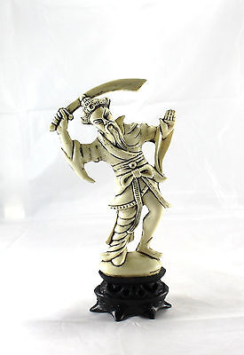 Vintage Cream Color Plastic Figurine Asian Man with Sword on Stand