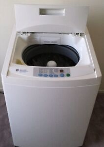 Apartment size GE 2.6 Cu.ft portable washer w wheel../canDeliver