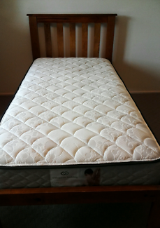 Massive wooden single bed with mattress