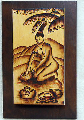 WOODEN ETCHED PICTURE OF TROPICAL LADY PREPARING FOOD