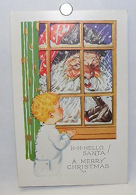 Vintage 1930s unused Christmas postcard: Child spies Santa outside the window