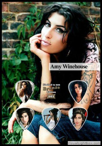 Amy Winehouse Guitar Picks On Photographic Background 5 Guitar Picks