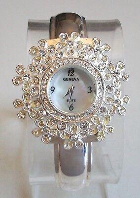 (Designer look flower silver finish rhinestone women fashion bangle dressy watch)
