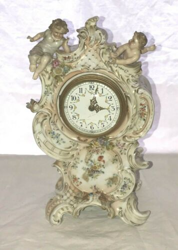 German Porcelain Clock. Raised Flowers and Figures of Children. c.1900 as is