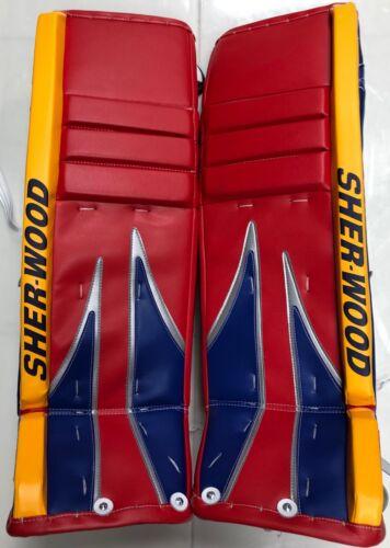 New Sherwood T100 M series Pro Stock Hockey Goalie Leg Pads 35+1 Red/Blue/Yellow