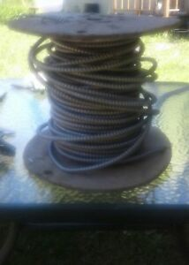 Armoured electrical copper wire on spool at least 3o ft