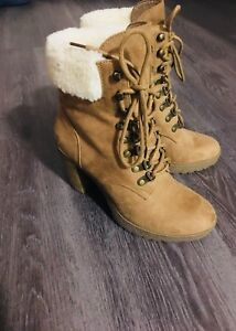 Brown-and-white fur-lined heeled lace-up boots