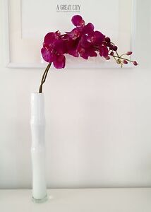 Modern white vase with orchids