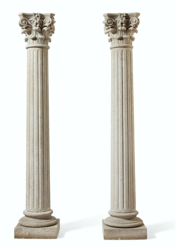 A PAIR OF ITALIAN COMPOSITION STONE COLUMNS/*Complimentary local delivery