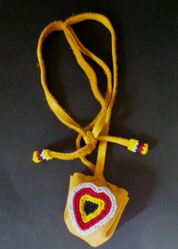 Beaded Heart design on moosehide Medicine Pouch; by Jack Ginnish Mi