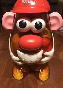 Mr Potato Heads and storage container