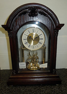 SEIKO MANTEL CLOCK IN WOODEN CASE WITH  3 ROTATING SWAROVSKI CRYSTALS PENDULUM