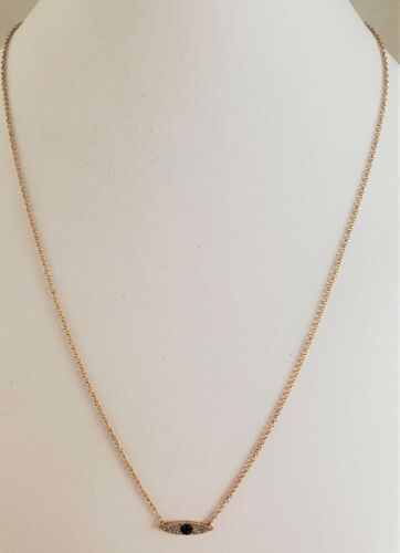 CHARMING 14 KT GOLD  with SAPPHIRE and DIAMOND EYE on 18 INCH CONVERTIBLE CHAIN