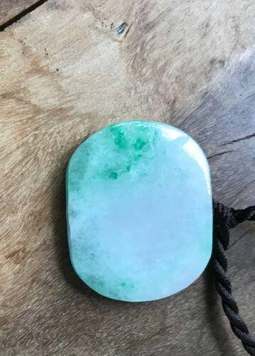 A Jadeite Pendant.  Qing Period.