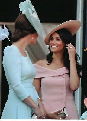 Catherine and Meghan chatting  during Trooping  2018  MINT