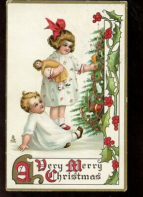 E526 Tuck Merry Christmas Two young Girls Doll tree Ribbons Postcard 1913 ()