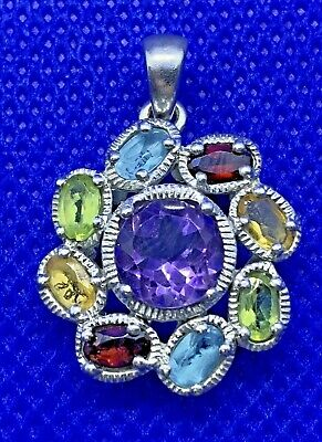 UNUSUAL STERLING SILVER CIRCULAR PENDANT WITH DIFFERENT COLOURED STONES