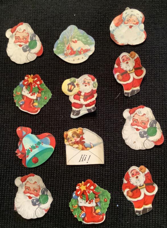 12 Vintage ephemera used mostly Santa Claus Christmas stickers From Scrapbook