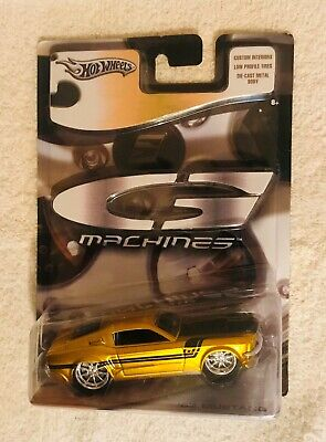 Hot Whwwls G-Machines 1/50 scale gold 68 Mustang in mint con dition