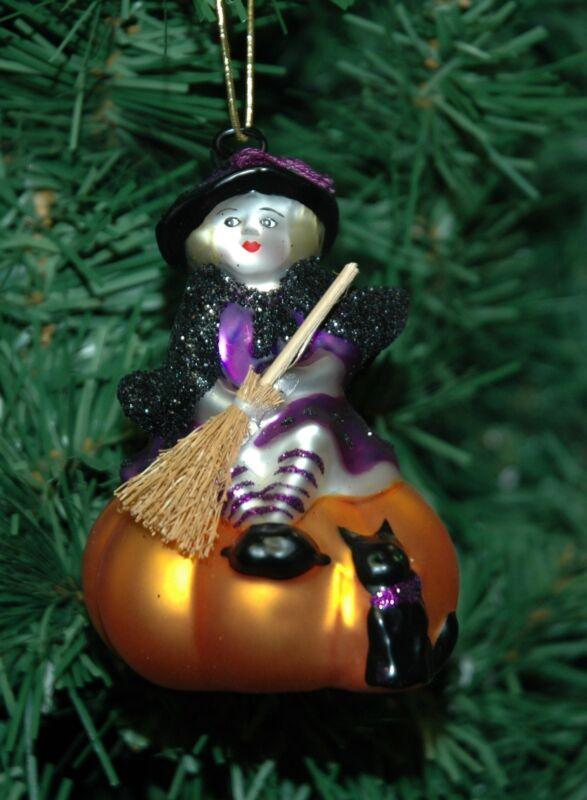 Blown Glass Halloween Witch On A Pumpkin Ornament