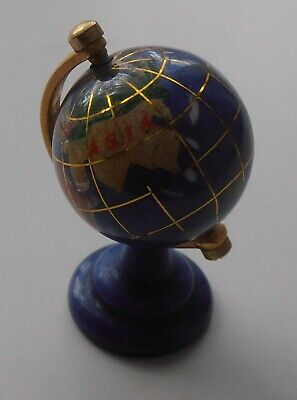 SMALL BLUE ROTATING GLOBE WITH INLAID STONES.