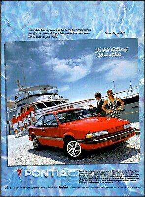 1990 Yacht & crew Pontiac sunbird red car man woman vintage photo print Ad ads33