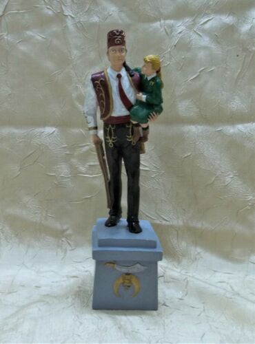 Shriners Holding Girl with Crutches Ceramic Figurine Masonic