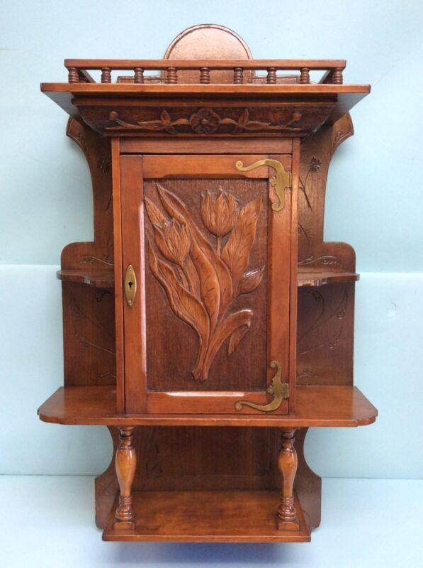 Handmade Carved Hanging Cabinet with Handcut Brass Elements