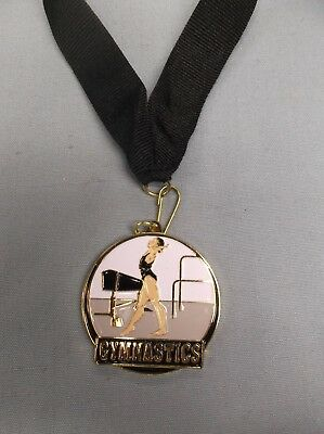 "female GYMNASTICS  color enameled medal with black neck drape 2"" diameter"