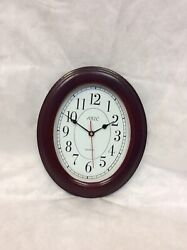 "Oval wall clock 11""x 9"" Cherry FINISH"