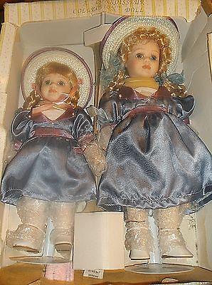 2 Seymour Mann porcelain sister dolls, original clothes & stands